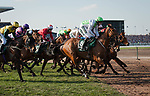 LIVERPOOL - APRIL 14: #8 Perfect Companion leads a group across the Melling Road in the Randox Health Grand National Steeplechase at Aintree Racecourse in Liverpool, UK (Photo by Sophie Shore/Eclipse Sportswire/Getty Images)