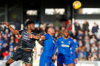 Darius Charles of AFC Wimbledon contests the ball with Ellis Harrison of Bristol Rovers during the Sky Bet League 1 match between AFC Wimbledon and Bristol Rovers at the Cherry Red Records Stadium, Kingston, England on 17 February 2018. Photo by Carlton Myrie.