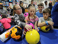 Pictured: Boys and girls with footballs at the till Wednesday 08 December 2016<br />Re: Swansea City FC players have bought Christmas gifts for 60 children at Smyths toy store in Swansea, south Wales.