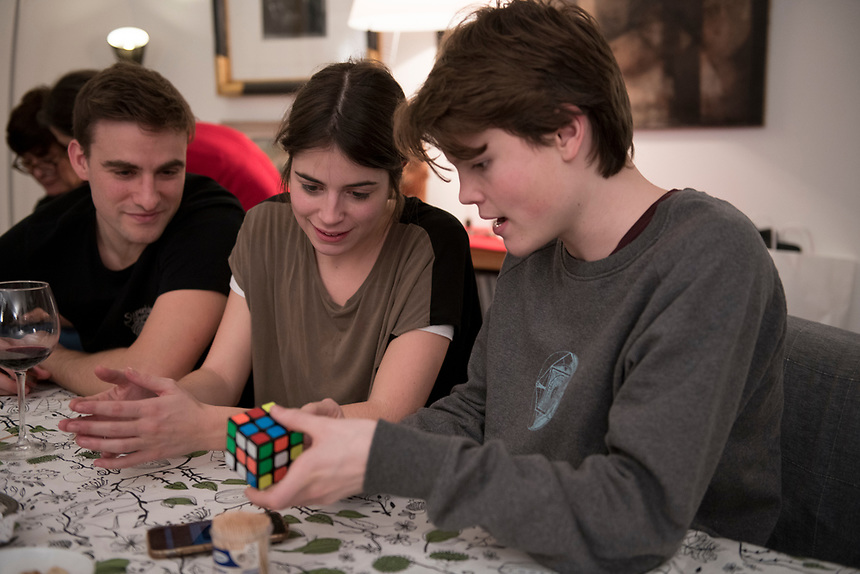 Felix showing Ana de Rubik's cube. Goodbye dinner with the Angulo family in Paco and Eli's apartment. Las Arenas, Getxo, Bilbao, Spain