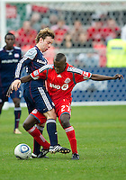 22 May 2010: New England Revolution forward Zack Schilawski #15 and Toronto FC defender/midfielder Gabe Gala #27 in action during a game between the New England Revolution and Toronto FC at BMO Field in Toronto..Toronto FC won 1-0.....
