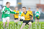 Tadhg O'Carroll of Ballydonoghue tries to block Stephen McCarthy of Listowel Emmetts in the Tim Kennelly League last Sunday in Listowel.