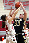 WOLCOTT CT. 10 December 2018-121018SV05-#33 Riley Kane of Woodland High goes up for a shot as #14 Morgan Matyoka of Wolcott High defends during 2nd quarter NVL basketball action in Wolcott Monday.<br /> Steven Valenti Republican-American