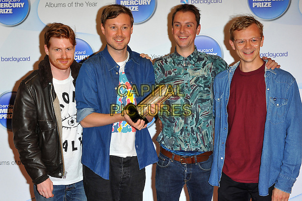 Django Django.Barclaycard Mercury Music Prize albums of the Year nominations 2012 held at the Hospital club - Arrivals London, England..September 12th, 2012.David Maclean, Vincent Neff, Jimmy Dixon, Tommy Grace half length band group black leather jacket white top blue jean denim shirt print red award trophy.CAP/CJ.©Chris Joseph/Capital Pictures.