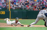 Baseball: Oakland Athletics Rickey Henderson steals base number 939, making him the all-time stolen base leader during game vs New York Yankees. Oakland, CA 5/1/1991 MANDATORY CREDIT: Brad Mangin/Sports Illustrated