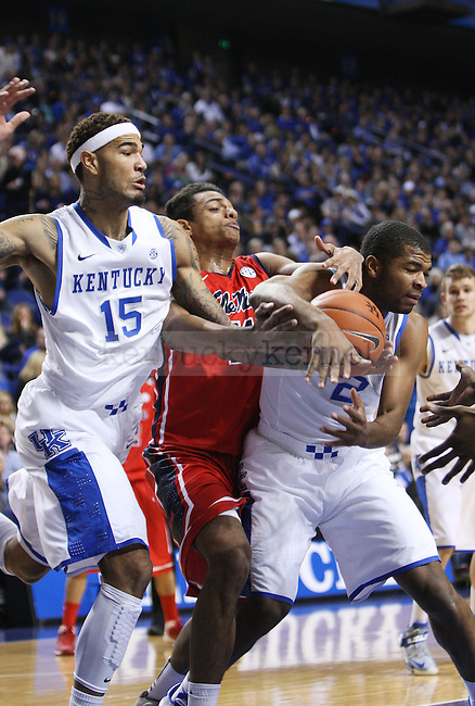 UK forward Willie Cauley-Stein (15) and guard Aaron Harrison (2) fight Ole Miss forward Sebastian Saiz (11) for the ball during the first half of UK Men's Basketball vs. Ole Miss at Rupp Arena in Lexington, Ky., on Tuesday, February 4, 2014. Photo by Emily Wuetcher | Staff