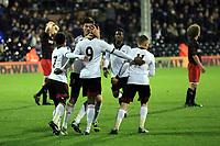 Moussa Dembele scores and celebrates his second Fulham goal