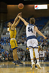 California Baptist guard Jeremy Smith (5) shoots over Nevada's Zach Wurm (54) in the second half of an NCAA college basketball game in Reno, Nev., Monday, Nov. 19, 2018. (AP Photo/Tom R. Smedes)