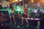 XIAN, CHINA - JUNE 2: Unidentified girls dance on a stage near the bar in a trendy nightclub on June 2, 2007 in central Xian, China. The themes change every night and popular artists from Shanghai, Beijing and Hong Kong perform daily. The city has about 3,3 million inhabitants and is the capital of Shaanxi province in China. It was the eastern terminus for the Silk Road and the location for the Terracotta Army during the Qin Dynasty. Its history dates back more than 3,100 years. (Photo by Per-Anders Pettersson).