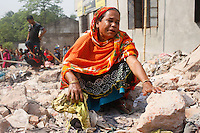 A Bangladeshi woman mourns her missing relative on the one-year  anniversary of the garment factory building collapse in Savar, near Dhaka, Bangladesh