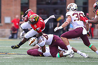 College Park, MD - September 22, 2018:  Minnesota Golden Gophers defensive lineman Winston DeLattiboudere (46) tackles Maryland Terrapins quarterback Kasim Hill (11) during the game between Minnesota and Maryland at  Capital One Field at Maryland Stadium in College Park, MD.  (Photo by Elliott Brown/Media Images International)