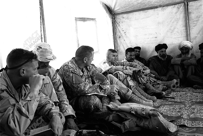 A refugee camp near Kandahar, US forces and Afghan Forces searching for Taliban. September 29th 2005...left to right: Unknown, Tarakey -Interpreter, John Newland -Civil Affairs, Colonel Ges commander of this operation.