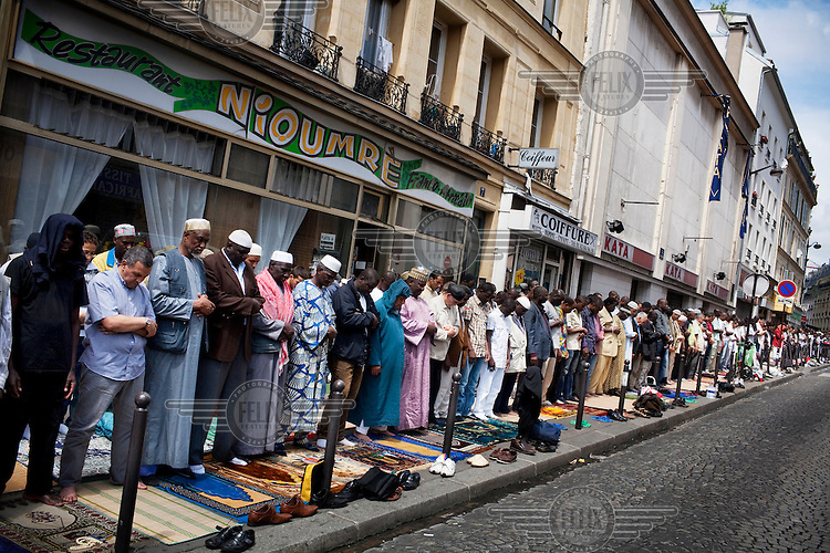 The Friday prayers outside the Al Fatah mosque inside the Goutte D'Or neighbourhood in Paris' 18th district.
