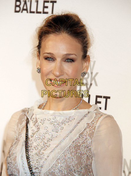 SARAH JESSICA PARKER .2011 New York City Ballet Spring Gala held at the David H. Koch Theater, Lincoln Center, New York, NY, USA, 11th May 2011..portrait headshot make-up beauty eyeliner hair up  earrings  smiling   white sheer see thru through  lace.CAP/ADM/AC.©Alex Cole/AdMedia/Capital Pictures.