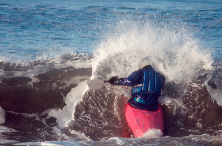 Surf kayaking, the Surf Frolic, La Push, Olympic Peninsula,  Washington State, Pacific Northwest, Pacific Ocean, Kayaker shatters a wave while trying to get through the break zone,.