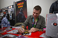 NEW YORK, USA - October 3: American Writer Charles Soule signs comic books on October 3, 2019 in New York, USA.<br /> The 2019 New York Comic-Con at the Jacob K. Javits Convention Center Day 1 with the latest in superhero movies, sci-fi shows, animation, video games, comic book releases available to attendees.<br /> (Photo by Luis Boza/VIEWpress/Corbis via Getty Images)