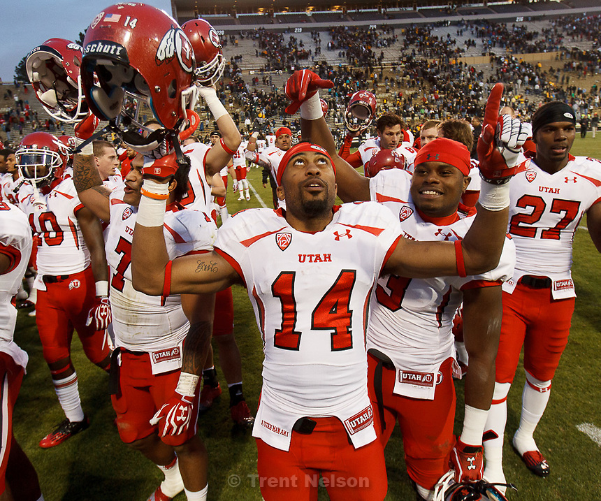"Trent Nelson  |  The Salt Lake Tribune.Utah Utes wide receiver Reggie Dunn (14) and the Utah team sings ""Utah Man"" following the win as the Colorado Buffaloes host the University of Utah Utes, college football Friday November 23, 2012 in Boulder."