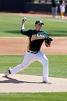 Trevor Cahill #53 of the Oakland Athletics pitches in an intrasquad game during spring training workouts at Phoenix Municipal Stadium on February 24, 2011  in Phoenix, Arizona. .Photo by:  Bill Mitchell/Four Seam Images.