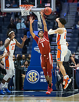 NWA Democrat-Gazette/BEN GOFF @NWABENGOFF<br /> Isaiah Joe, Arkansas guard, gets his hand on the ball as Dontay Bassett, Florida forward, shoots in the first half Thursday, March 14, 2019, during the second round game in the SEC Tournament at Bridgestone Arena in Nashville.