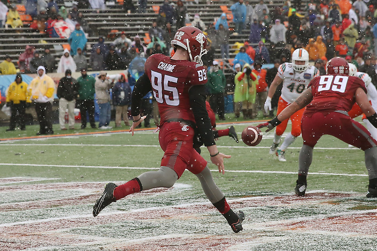 Zach Charme, Washington State University punter, prepares to make a crucial punt near the end of  the Hyundai Sun Bowl game against the Miami Hurricanes in El Paso, Texas, on December 26, 2015.  In a game that could have been named the Snow Bowl instead of the Sun Bowl, WSU took a 20-7 lead in to halftime and then held off a Miami fourth quarter rally to win their first bowl game since the 2003 Holiday Bowl, 20-14.