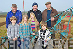 LAND: The Doyle children given a hand at the Ardfert ploughiung competition on Sunday on Jim Healy's Land, Ardfert, L-r: Adam,Jane,Katie and Billy Doyle. Back l-r: Aeneas Horan,Oliver Tonsle and Jerome Quirke (Fenit)................... . ............................... ..........
