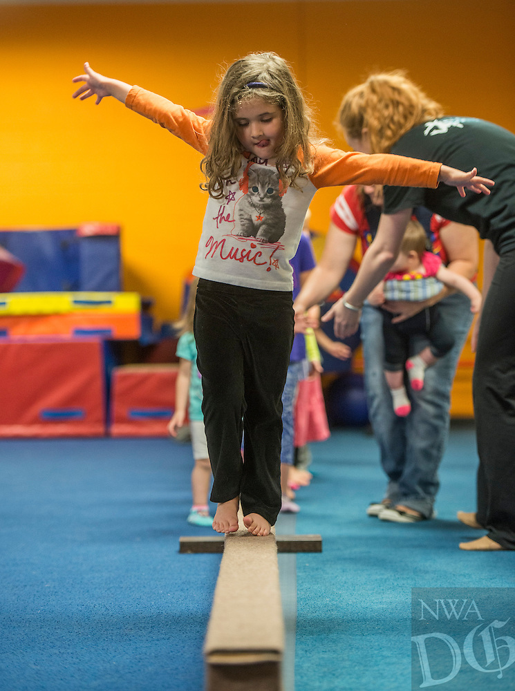 NWA Democrat-Gazette/ANTHONY REYES &bull; @NWATONYR<br /> Violet Ginn, 4, walks along a balance beam Tuesday, April 12, 2016 during a gymnastics class demonstration at the Jones Center in Springdale. The demonstration was part of the Center's open house for children's classes. The open house featured a few vendors and demonstrations of different classes offered at the Jones Center including gymnastics, mommy and me yoga and ballet.