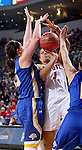 SIOUX FALLS, SD - MARCH 8:  Jasmine Trimboli #5 from the University of South Dakota takes the ball between a pair of defenders including Ellie Thompson #45 from South Dakota State University in the championship game of the 2016 Summit League Tournament Tuesday afternoon in Sioux Falls. (Photo by Dave Eggen/Inertia)