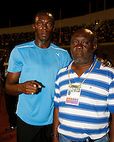 Usain Bolt and Coach Mills at the Jamaica International Invitational Meet on Saturday, May 3rd. 2008. Photo by Errol Anderson, The Sporting Image.