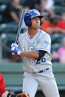 Center fielder Alfredo Escalera-Maldonado (26) of the Lexington Legends bats in a game against the Greenville Drive on Sunday, August 31, 2014, at Fluor Field at the West End in Greenville, South Carolina. Greenville won, 3-2. (Tom Priddy/Four Seam Images)