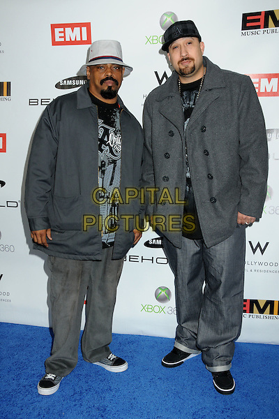 CYPRESS HILL - Sen Dog and B-Real .EMI Post Grammy Party 2010 held at the W Hollywood Hotel, Hollywood, California, USA, 31st January 2010..full length grey gray hat hand gesture cap coat jacket goatee facial hair jeans trainers black grammys .CAP/ADM/BP.©Byron Purvis/Admedia/Capital Pictures