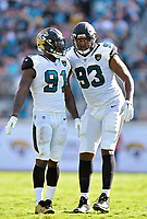 Jacksonville Jaguars defensive ends Yannick Ngakoue (91) and Calais Campbell (93) plan their attack against the Los Angeles Rams in a NFL game Sunday, October 15, 2017 in Jacksonville, Fl.  (Rick Wilson/Jacksonville Jaguars)