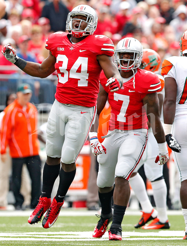 Ohio State Buckeyes defensive end Jamal Marcus (34) and Ohio State Buckeyes running back Rod Smith (7) celebrate a blocked punt by Ohio State Buckeyes cornerback Doran Grant (12) (not in photo) against Florida A&M Rattlers in the 1st quarter during their college football game at Ohio Stadium on September 21, 2013.  (Dispatch photo by Kyle Robertson)