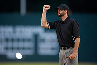 Umpire Jesse Osborne calls an out during a Collegiate Summer League game between the Macon Bacon and Savannah Bananas on July 15, 2020 at Grayson Stadium in Savannah, Georgia.  (Mike Janes/Four Seam Images)