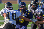 Santa Monica, CA 10/17/13 - unidentified Santa Monica player(s) and Cameron Ghaffari (Peninsula #10) in action during the Peninsula vs Santa Monica Junior Varsity football game at Santa Monica High School.