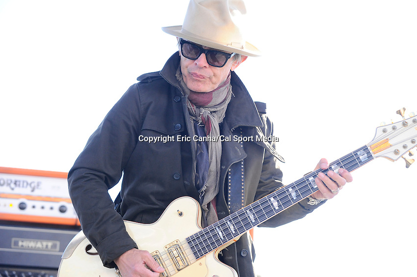 Sunday, September 25, 2016: Tom Petersson of Cheap Trick performs for spectators before the NASCAR Sprint Cup Series Bad Boy Off Road 300 race held at the New Hampshire Motor Speedway in Loudon, New Hampshire. Sprint Cup Series driver Kevin Harvick (4) won the race. Eric Canha/CSM