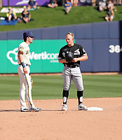 Brice Turang, Milwaukee Brewers (left) - Andrew Vaughn, Chicago White Sox (right) - 2020 spring training (Bill Mitchell)