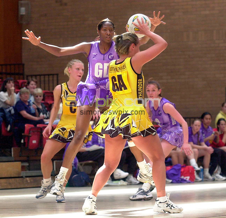Pix:BEN DUFFY/SWpix.com. Netball - England Netball Super Cup Round 1, Gateshead......Northern Thunder v Petchley London Tornadoes ......10/05/2003...COPYRIGHT PICTURE>>SIMONWILKINSON>>01943 436649>>..Thunder's Tracey Nevill tries to slip a pass past  Tornadoe's Janet Coulbourne