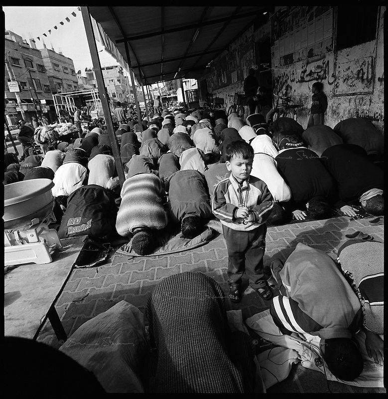 Rafah, Gaza Strip, Jan 16 2009.The funeral prayer for Aissa Mohammed Armilat, 12, who was in the garden in front of his house in eastern Rafah at 7AM when an Israeli shell killed him on the spot. There was no fighting activity whatsoever in the area..