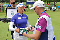 So Yeon Ryu (KOR) is presented the Rolex Golden Bib to present to her caddie as the new world's number one female golfer during Thursday's round 1 of the 2017 KPMG Women's PGA Championship, at Olympia Fields Country Club, Olympia Fields, Illinois. 6/29/2017.<br /> Picture: Golffile | Ken Murray<br /> <br /> <br /> All photo usage must carry mandatory copyright credit (&copy; Golffile | Ken Murray)