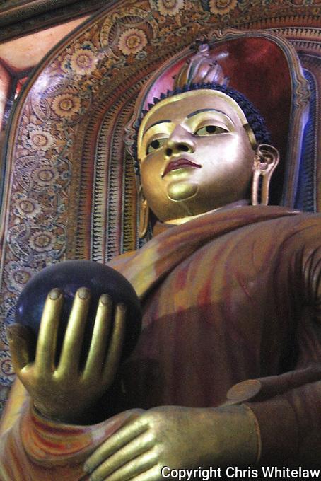 Standing Buddha statue (holding wealth ball), Wewurukannala Vihara, Dikwella, Sri Lanka