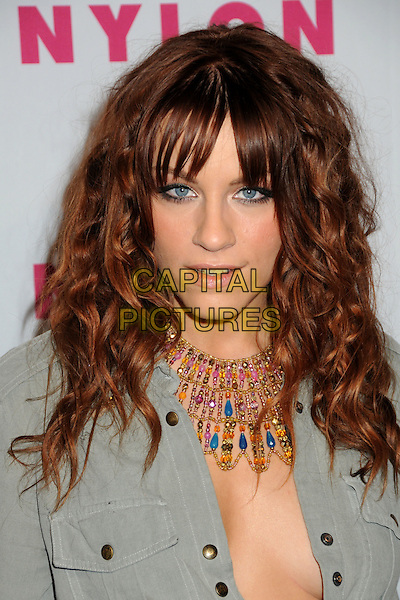 BRIT MORGAN.Nylon Magazine's Young Hollywood Party held at the Roosevelt Hotel's Tropicana Bar, Hollywood, California, USA..May 12th, 2010.headshot portrait grey gray shirt beads beaded necklace plunging neckline cleavage .CAP/ADM/BP.©Byron Purvis/AdMedia/Capital Pictures.
