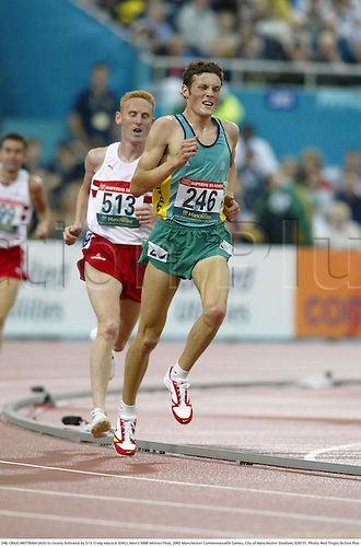 246. CRAIG MOTTRAM (AUS) is closely followed by 513. Craig Mayock (ENG), Men's 5000 Metres Final, 2002 Manchester Commonwealth Games, City of Manchester Stadium, 020731. Photo: Neil Tingle/Action Plus...athletics athletes athlete.runner runners run running.track event.distance