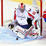 10 February 2010: Washington Capitals' goaltender Jose Theodore makes a second period save against the Montreal Canadiens at the Bell Centre in Montreal, Quebec, Canada. The Canadiens defeated the Capitals 6-5 in sudden death overtime, ending Washington's team-record winning streak at 14 games. Mandatory Credit: Ed Wolfstein Photo