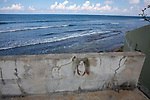 Faces In Sea Wall