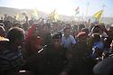 Iraq 2009.Kurdish Peshmergas trying to control the rush of supporters of PKK 's guerillas going back to Turkey.Irak 2009.Peshmergas essayant de controler la foule des sympathisants accompagnant jusqu'a la frontiere des combattants du PKK rentrant en Turquie..