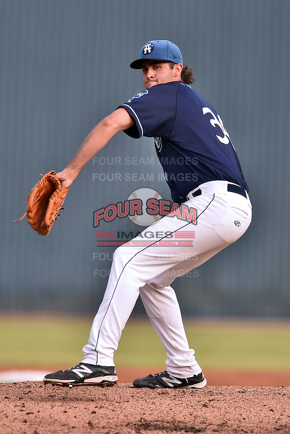 Asheville Tourists starting pitcher Alex Balog #34 delivers a pitch during a game against the  Greenville Drive at McCormick Field June 26, 2014 in Asheville, North Carolina. The Tourists defeated the Drive 9-4. (Tony Farlow/Four Seam Images)