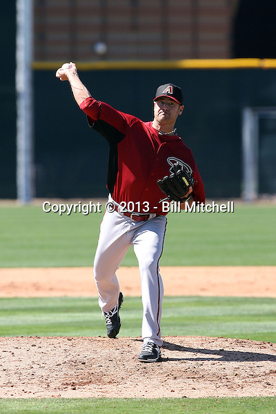 """Josh Booty, winner of MLB Networks """"The Next Knuckler"""" contest, pitches in his first game for the Arizona Diamondbacks in a spring training """"B"""" game against the San Francisco Giants at Salt River Fields on March 10, 2013 in Scottsdale, Arizona (Bill Mitchell)"""