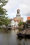 View over Rijn canal waterway to Hartebrugkerk church Leiden, Netherlands