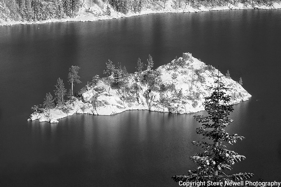 """Winter Tea Castle"" Black and White.  I captured this image of Fannette Island located in Emerald Bay, South Lake Tahoe during the winter in December 2012.  The road was closed so I hiked out to Inspiration Point at Emerald Bay on Christmas Eve after a huge snowstorm capturing the island completely covered with fresh snow.  I have a series of four photographs posted that range from a close up of Fannette Island to the wide angle that includes more of Emerald Bay and Lake Tahoe. Winter Tea Castle, Fannette Freshies, Inspiration, and White Christmas."
