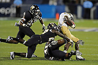 17 September 2011:  FIU defensive back Jose Cheeseborough (27), with some help from linebacker Kenneth Dillard (41) and defensive back Terrance Taylor (23), brings down UCF wide receiver Quincy McDuffie (14) in the second half as the FIU Golden Panthers defeated the University of Central Florida Golden Knights, 17-10, at FIU Stadium in Miami, Florida.
